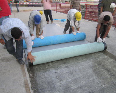 Workers and rolls of materials